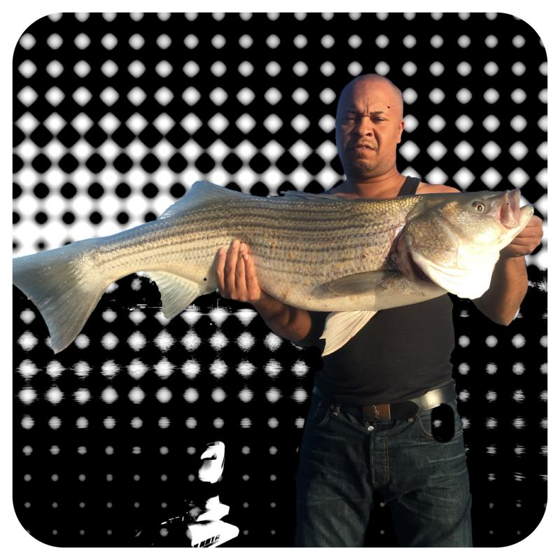 Client Holding A Nice Lake Martin Striper - Got You Hooked Guide Service